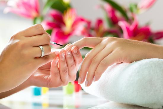 64f5536c_bigstock-woman-in-a-nail-salon-receivin-37087198